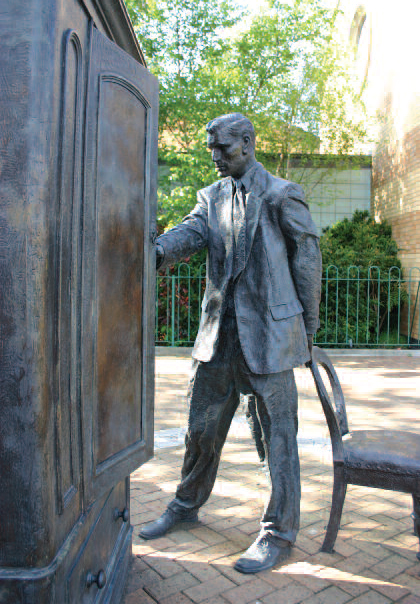 Ross Wilson, The Searcher, statue of C.S. Lewis looking into a wardrobe, Belfast, Ireland