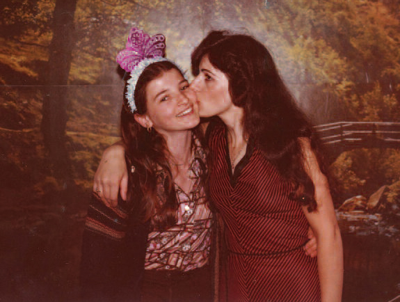 Xharije kissing the author at her sweet sixteen party, 1979