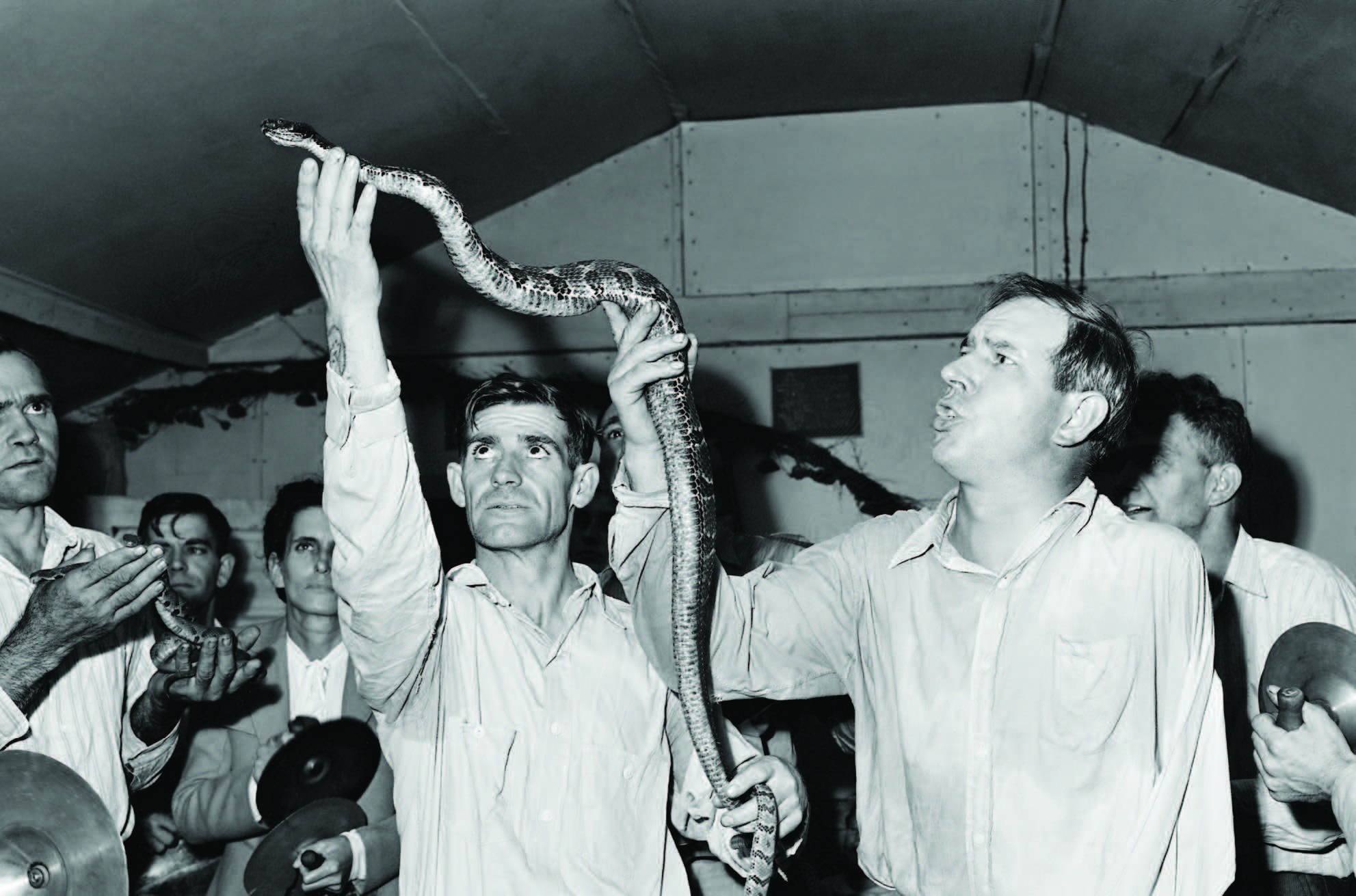 Handling serpents at the Pentecostal Church of God. September 15, 1946. Photograph by Russell Lee. Lejunior, Harlan County, Kentucky