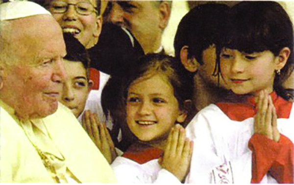 Pope John Paul II with altar girls. Photograph by Kurt20008